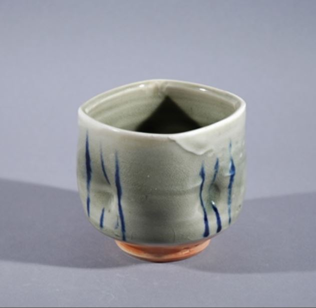 Barbara Tipton. c.2016. Yunomi. Wood and soda-glazed porcelain, celadon impressions, handpainted. 8.9 x 8.9 cm.