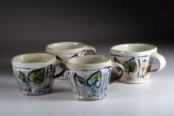 Barbara Tipton. 2014. Latte cups, wheel thrown porcelain, 10 cm high, brush decoration with cobalt/manganese stain, green glaze, wood/soda firing.