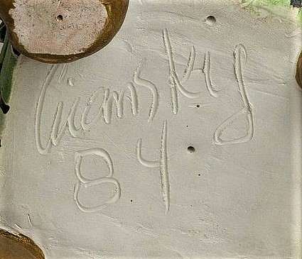 "Victor Cicansky signature. ""Cicansky 84"", A typical engraved signature, this on the base of a chair sculpture."
