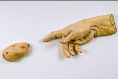 Victor Cicansky. The Creation of the Potato. Clay, glaze, wood backing. 41.9 x 74.9 x 8.9 cm. 1993