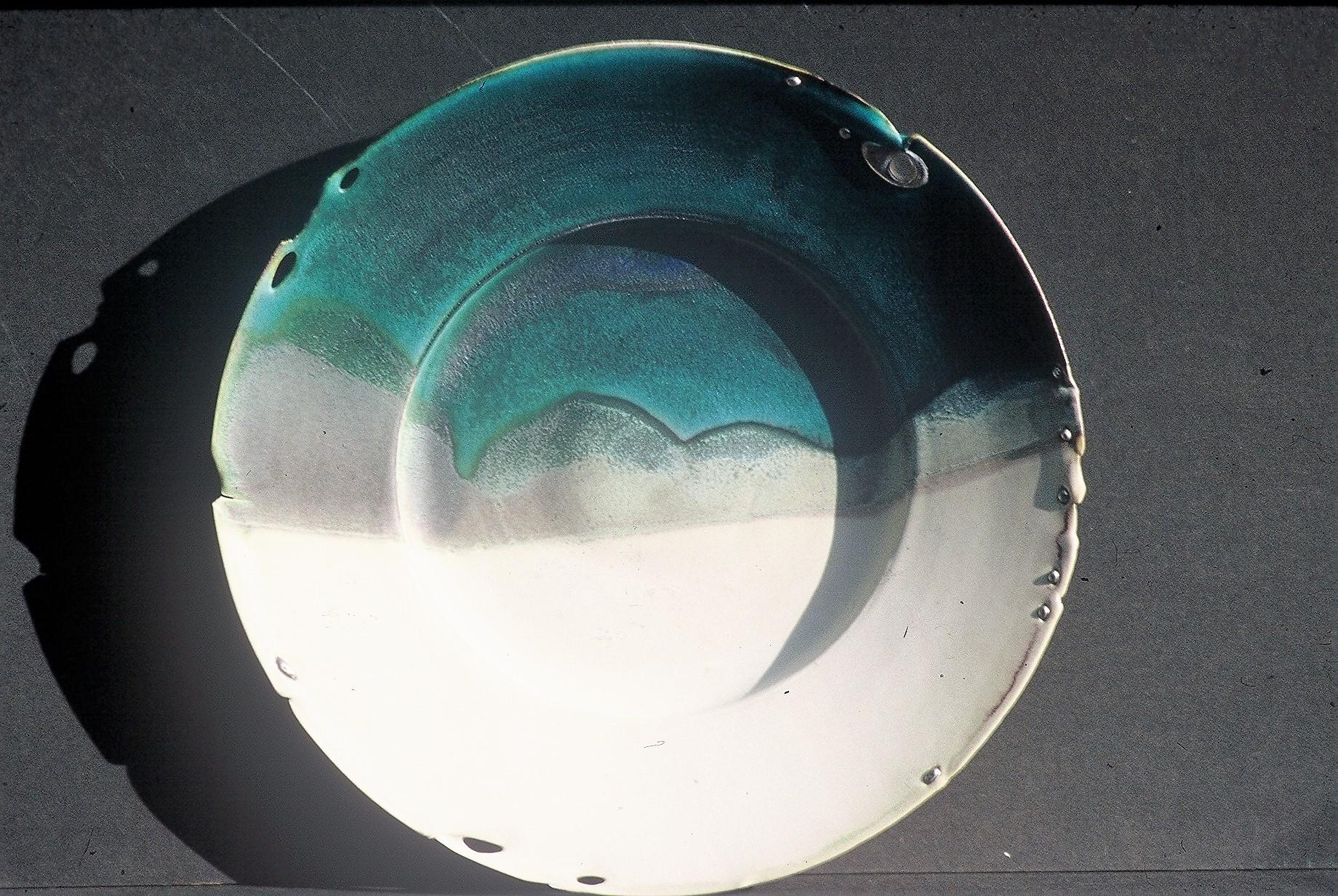 "Valerie Metcalfe.1983. Landscape plate: ""Prairie Winter"" porcelain, solder, glass. 43.2 cm w."