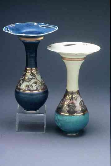 Valerie Metcalfe. 2005. Two Bud vases. Porcelain, solder and gold lustre. 17.8 cm h. (Thrown in one piece)