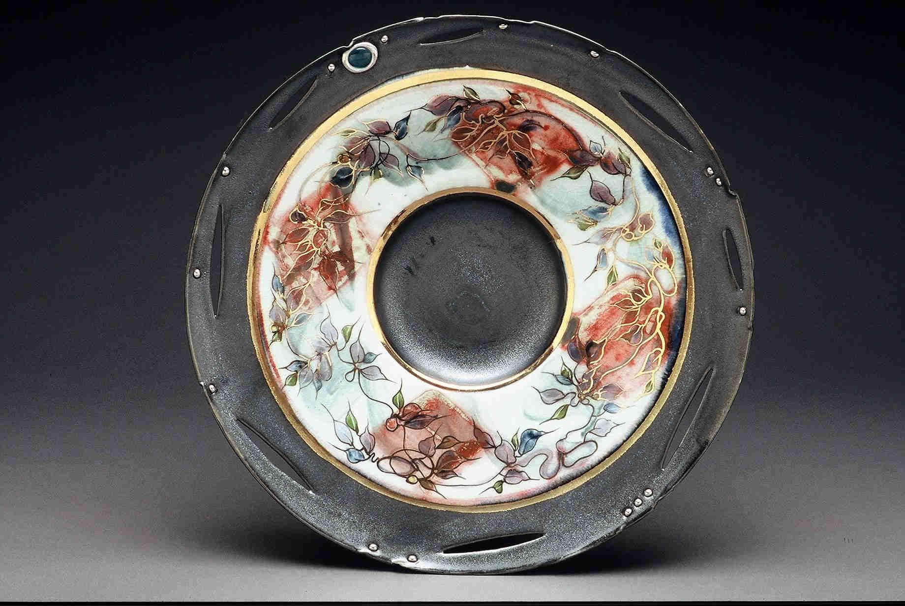 """Valerie Metcalfe. 2005. Porcelain, solder, glass, 18"""" wide"""