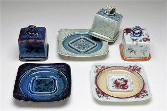 Valerie Metcalfe. 2010. Butterdishes. Porcelain. Plate/base: 17.8 x 17.8 cm; top: 8.9 square x 11. 4 cm high.