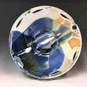 Valerie Metcalfe.. 2017. Skyscape/Landscape plate. Porcelain, solder, glass. 40.6 cm w.