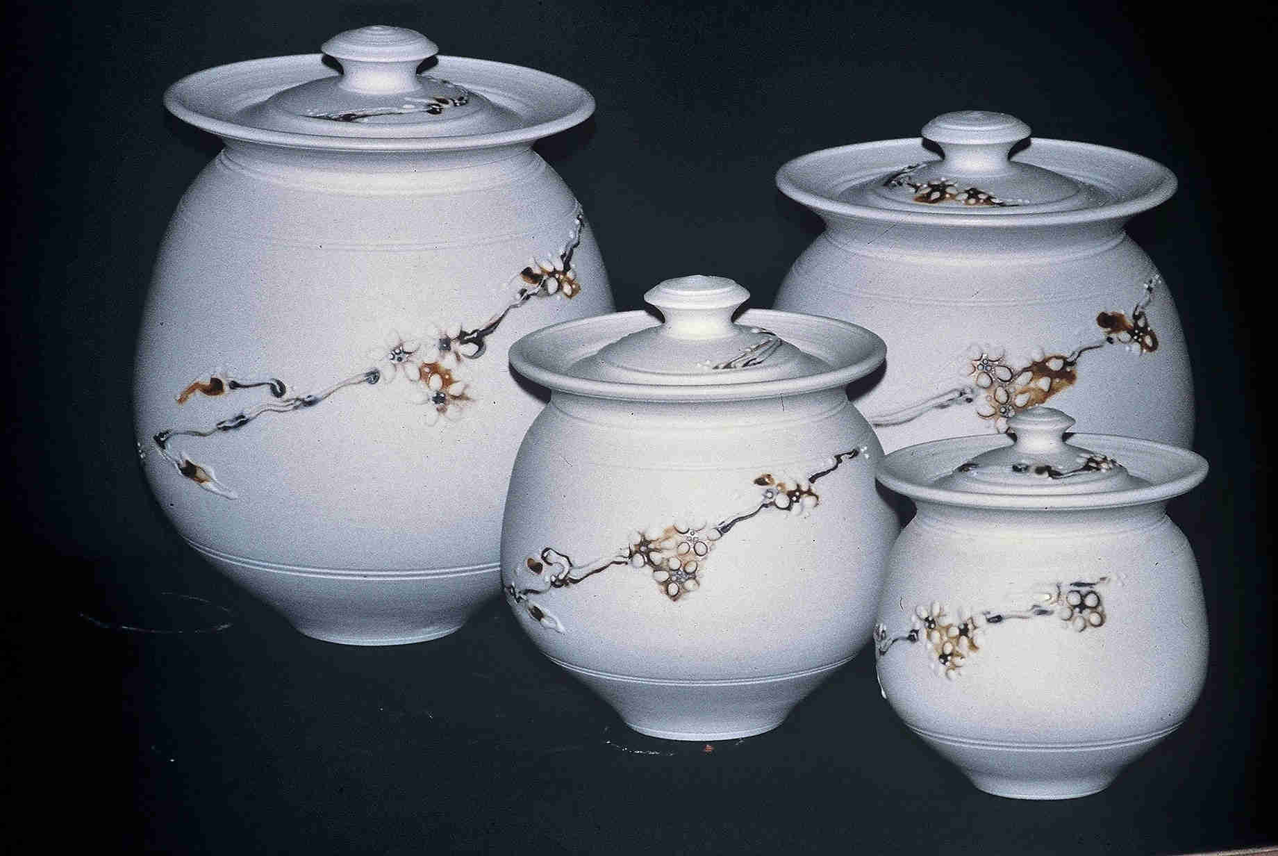Valerie Metcalfe. Cannister Set. 1980. Porcelain ( unglazed). Left to right: 33 cm, 22.9 cm, 27. 9 cm, and 17.8 cm.