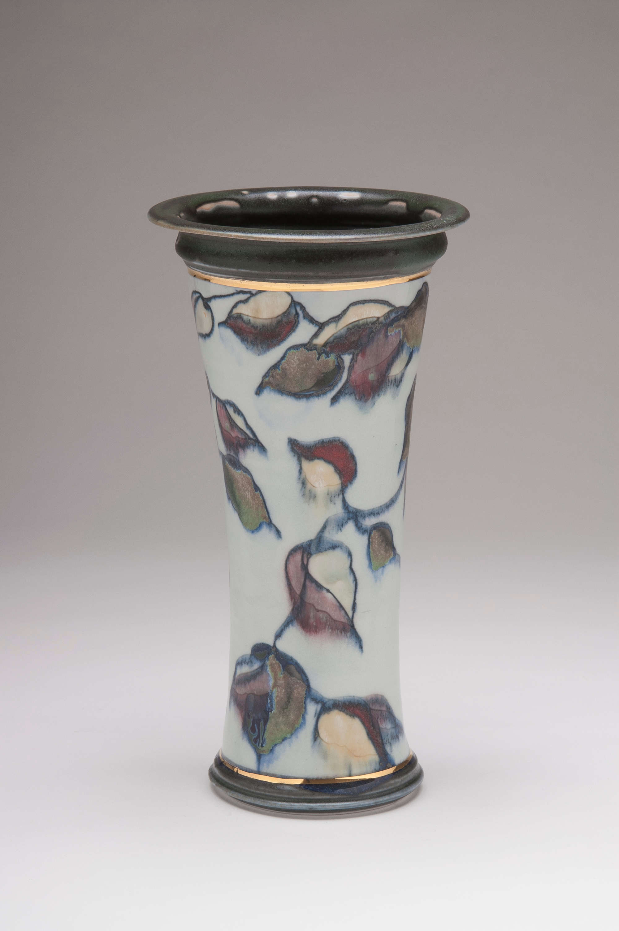 Valerie Metcalfe. Forest vase. 2018, Porcelain and Gold Lustre. Carved Mishima design with painted glazes, underglazes and wax. 38.1 cm high.