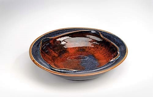 Donn Zver. 2015. Large thrown bowl, stoneware, cone 11. Multi glazes in centre with midnight blue in outer area. 10.2 x 35.6 cm.