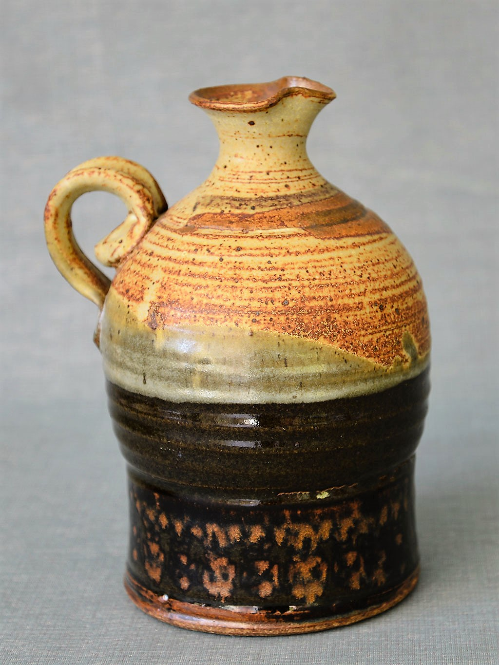 Donn Zver. (1973-83) Jug. 22.0 x 17.0 x 14.4 cm. Thrown stoneware, glaze with stamped design. Collection: Art Gallery of Burlngton.