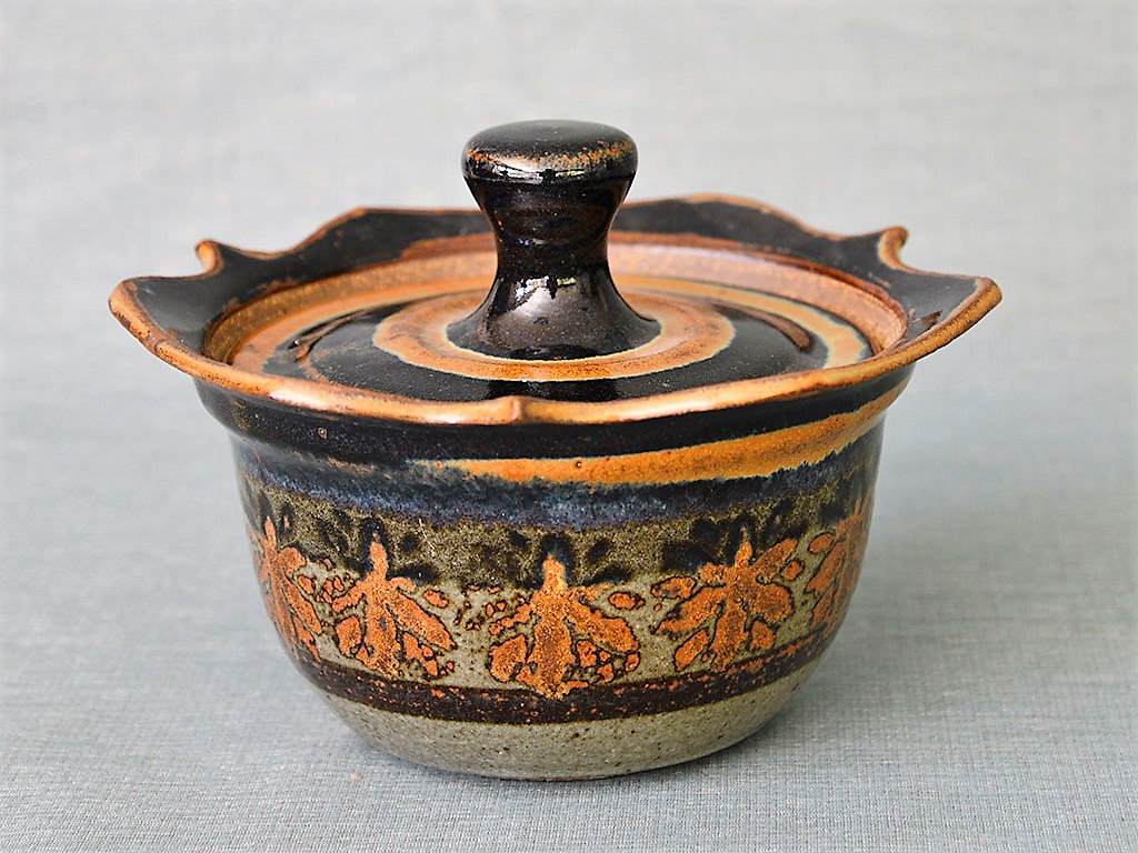 Donn Zver. 1985 Covered Casserole #2. 15.8 x 21.4 x 22.3 cm. Thrown stoneware, glaze with stamped decoration of iron and rutile oxide. Collection: Art Gallery of Burlington
