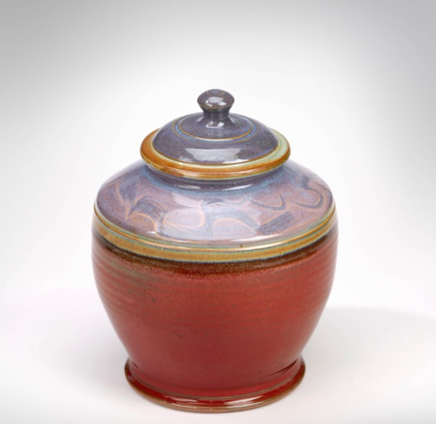 Donn Zver. 1985. Stoneware Jar. Copper red glaze with a opal blue top. 33 x 22.9 cm.