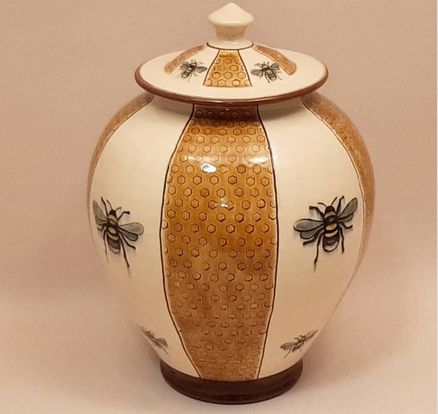 Birdsall Worthngton (Tim Worthington) Pale Yellow Bee Jar. 26.7 cm tall. Lantz clay with white slip and underglaze and stamped decoration. Transparent coloured glaze over the stamped honeycomb. Cone 03.