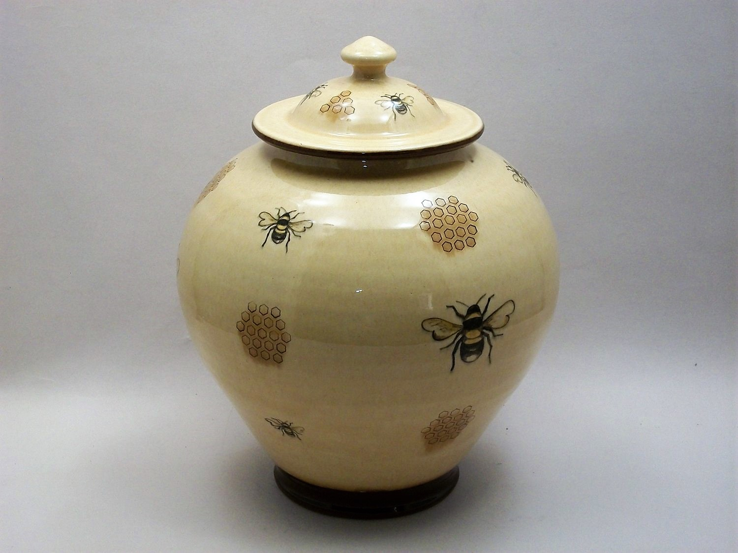 Tim Worthington. Pale Yellow Bee Jar. Lantz clay. Underglaze hand painted decoration on a white clay slip background, covered with a pale transparent yellow glaze. 26.7 cm.